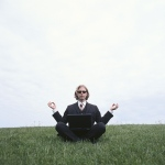 Guy in suit meditating