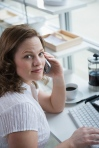 home office woman cell phone